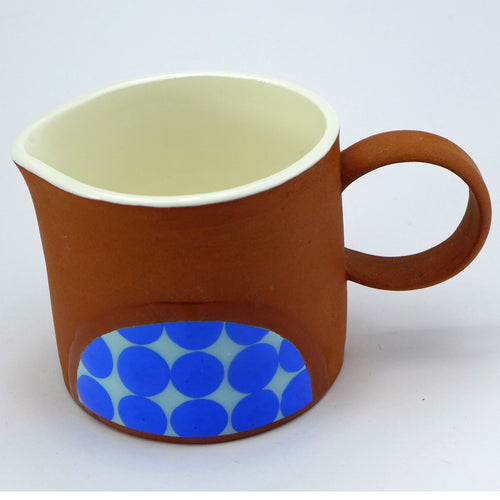 Small jug bright blue spots