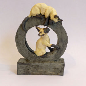 Ceramic cats on a hoop