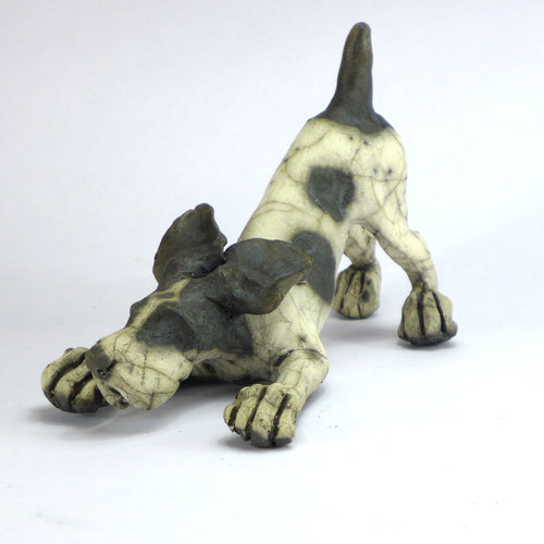 Ceramic bounding dog
