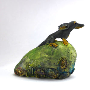 Ceramic dachshund in the wind (on a hill)