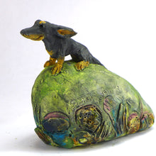Load image into Gallery viewer, Ceramic dachshund in the wind (on a hill)
