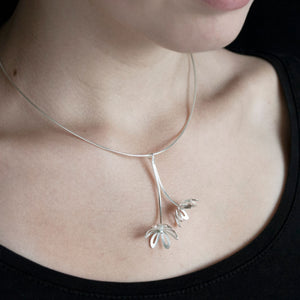 GCP24 Silver outline flower pendant