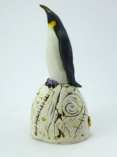 Small ceramic penguin on a hill with gold lustre