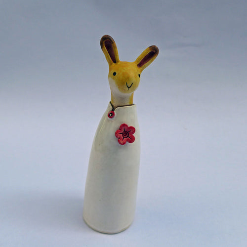 Ceramic hare in a shiny coat with a flower