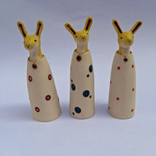 Load image into Gallery viewer, Ceramic hare in a coat with teal double spots