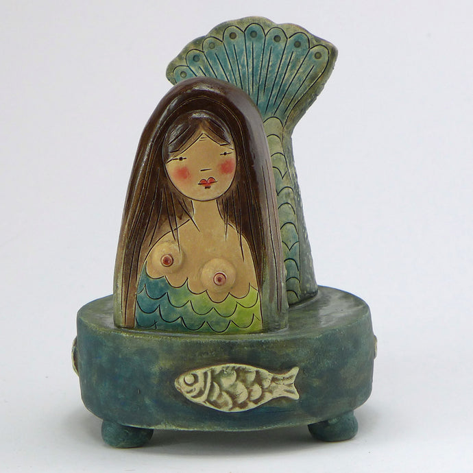 Ceramic mermaid on a stand