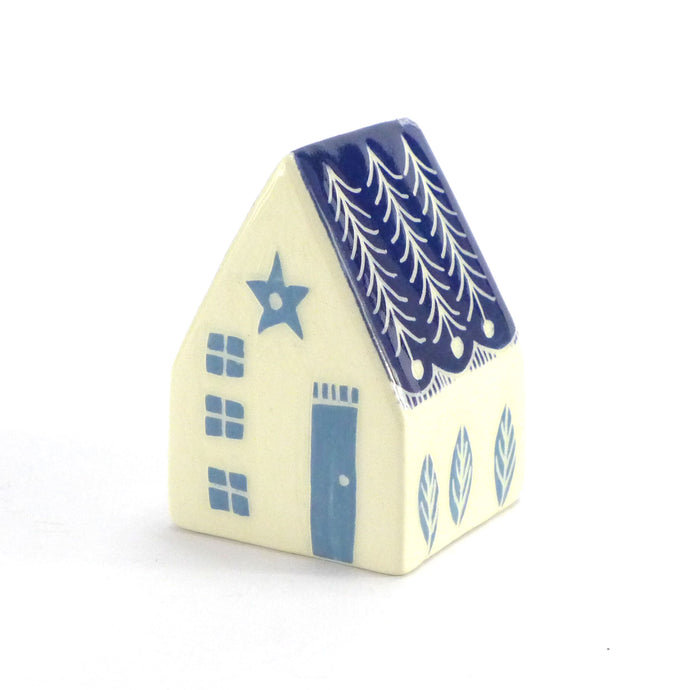 Small ceramic house white with fir roof