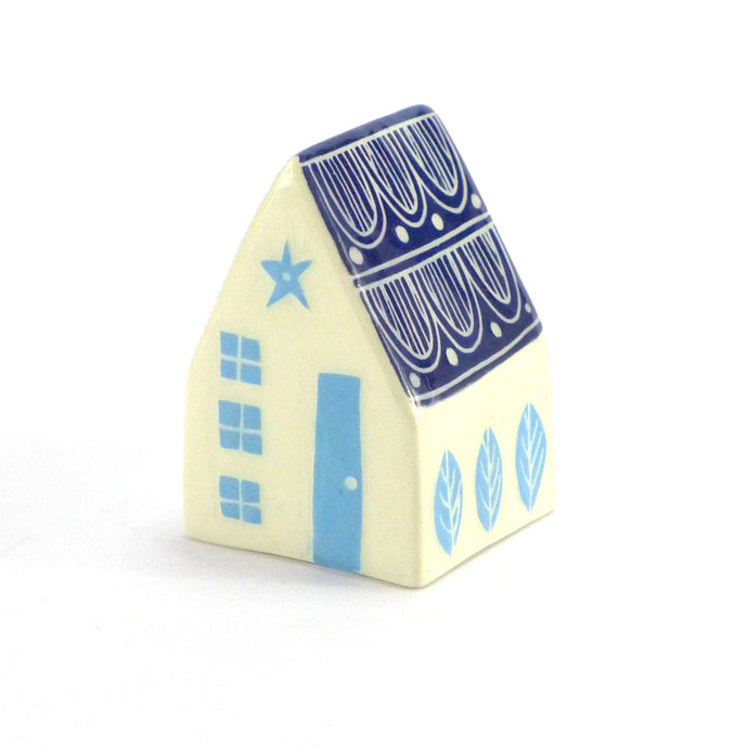 Small ceramic house white with tiled roof