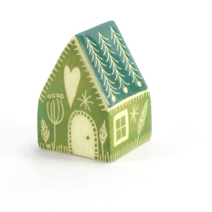 Small ceramic house green fir roof