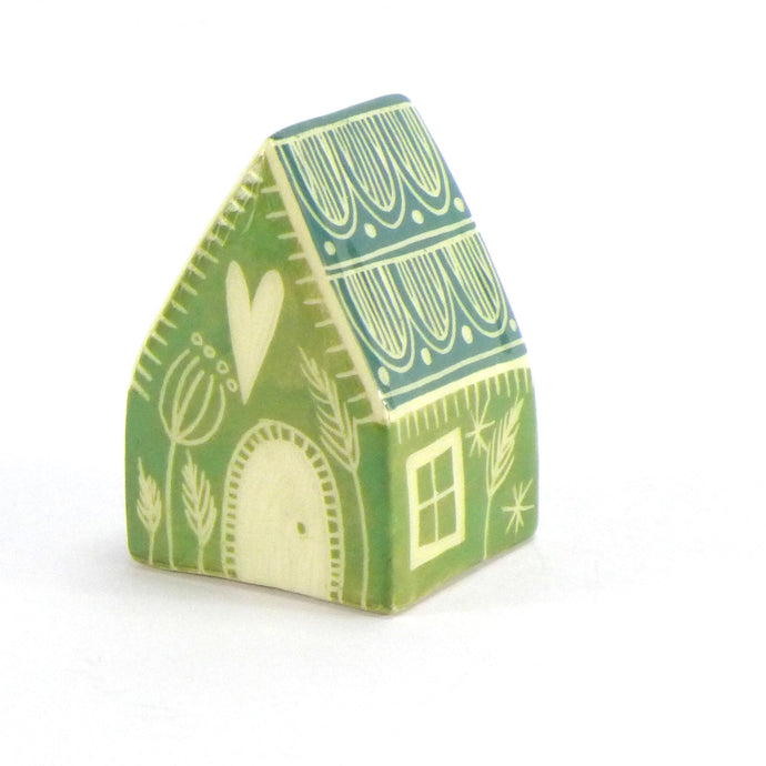 Small ceramic house green tile roof