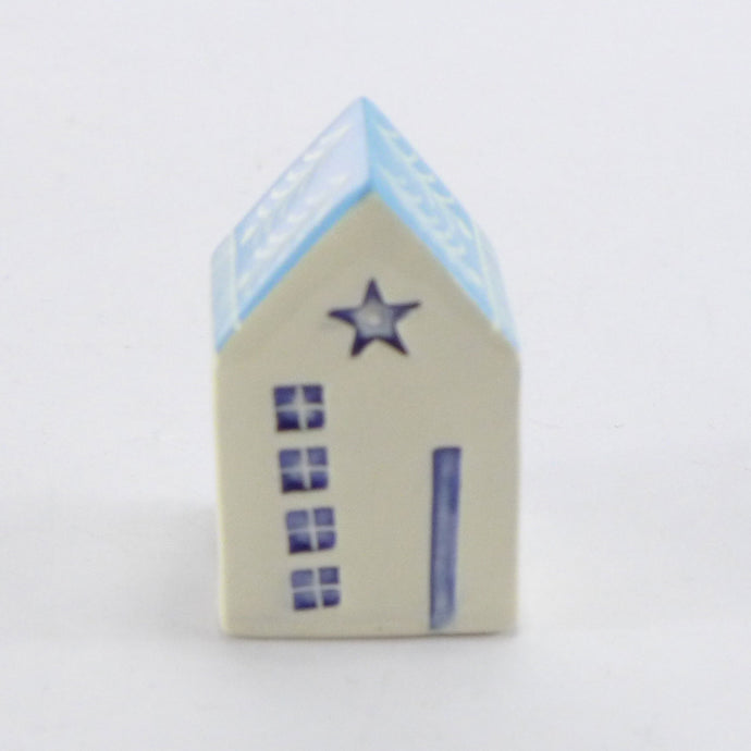 Tiny ceramic house turquoise star