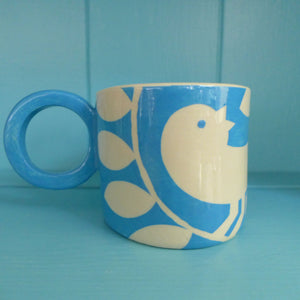 Bright blue ava bird mug