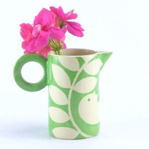 Bright green ava bird baby jug