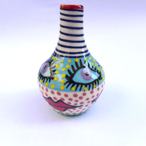 Eyes and lips small bottle vase