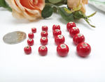 50 x red hollow ceramic beads