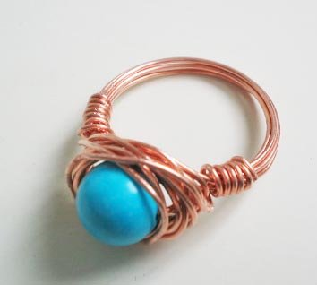 Wire wrapped ring - Turquoise bead with red copper