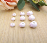 50 x pink hollow ceramic beads