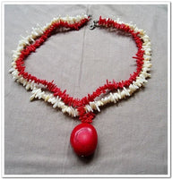 16.5'' red white coral chip with ellipsoid pendant