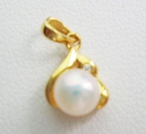 Pearl pendant on sterling silver bail - Small white & golden