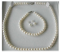 A set of three - White pearl necklace bracelet earrings set