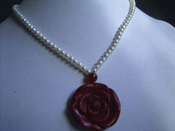 18'' white pearl necklace with coral flower pendant