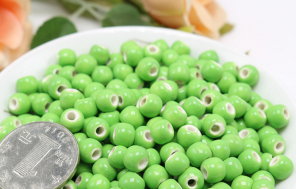 50 x light green hollow ceramic beads