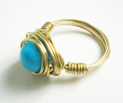 Wire wrapped ring - Turquoise bead with golden copper
