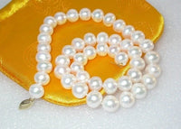 Slick surface 10mm round white FW pearls necklace 9k