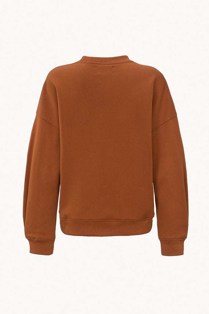 Organic sweater with pleated detail rust back