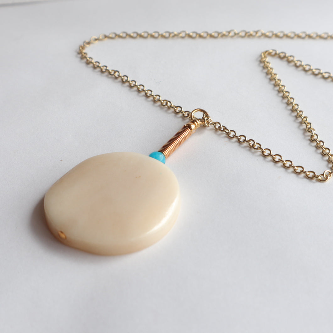 cream pendant gold chain