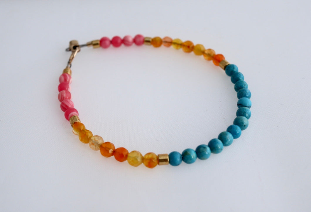 multi coloured gemstone layering bracelet handmade in ireland with gold clasp by alison walsh