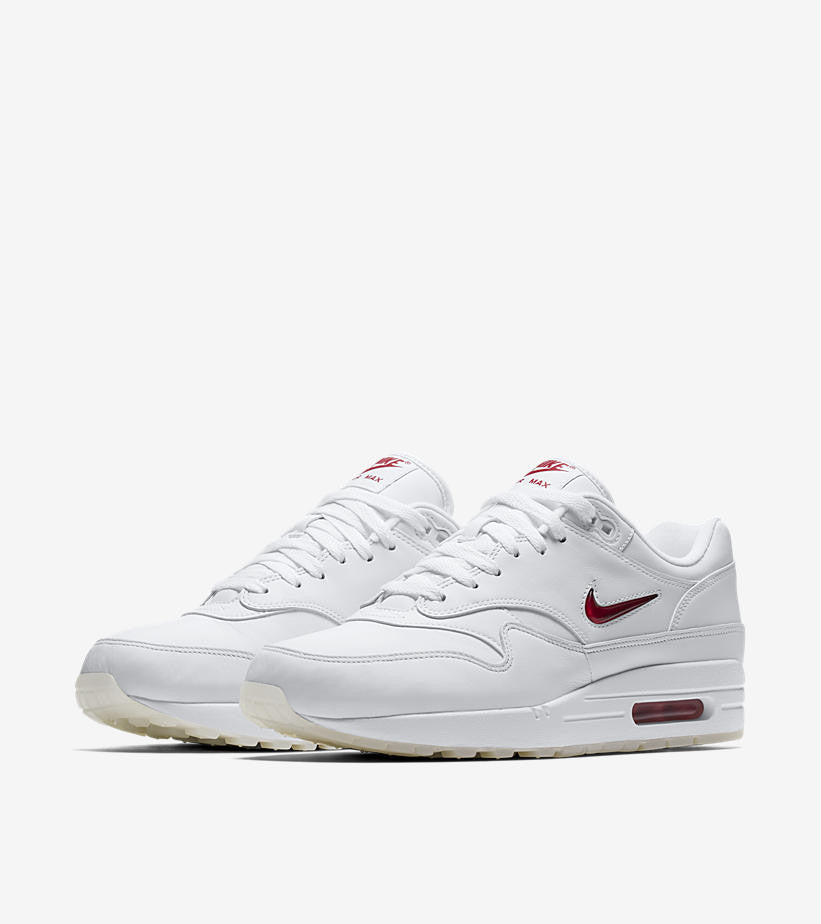 finest selection 41c76 dc626 The Nike Air Max 1 Jewel is featured in a white colorway with red jewels  and accents as well as a white colorway with black jewels and accents.