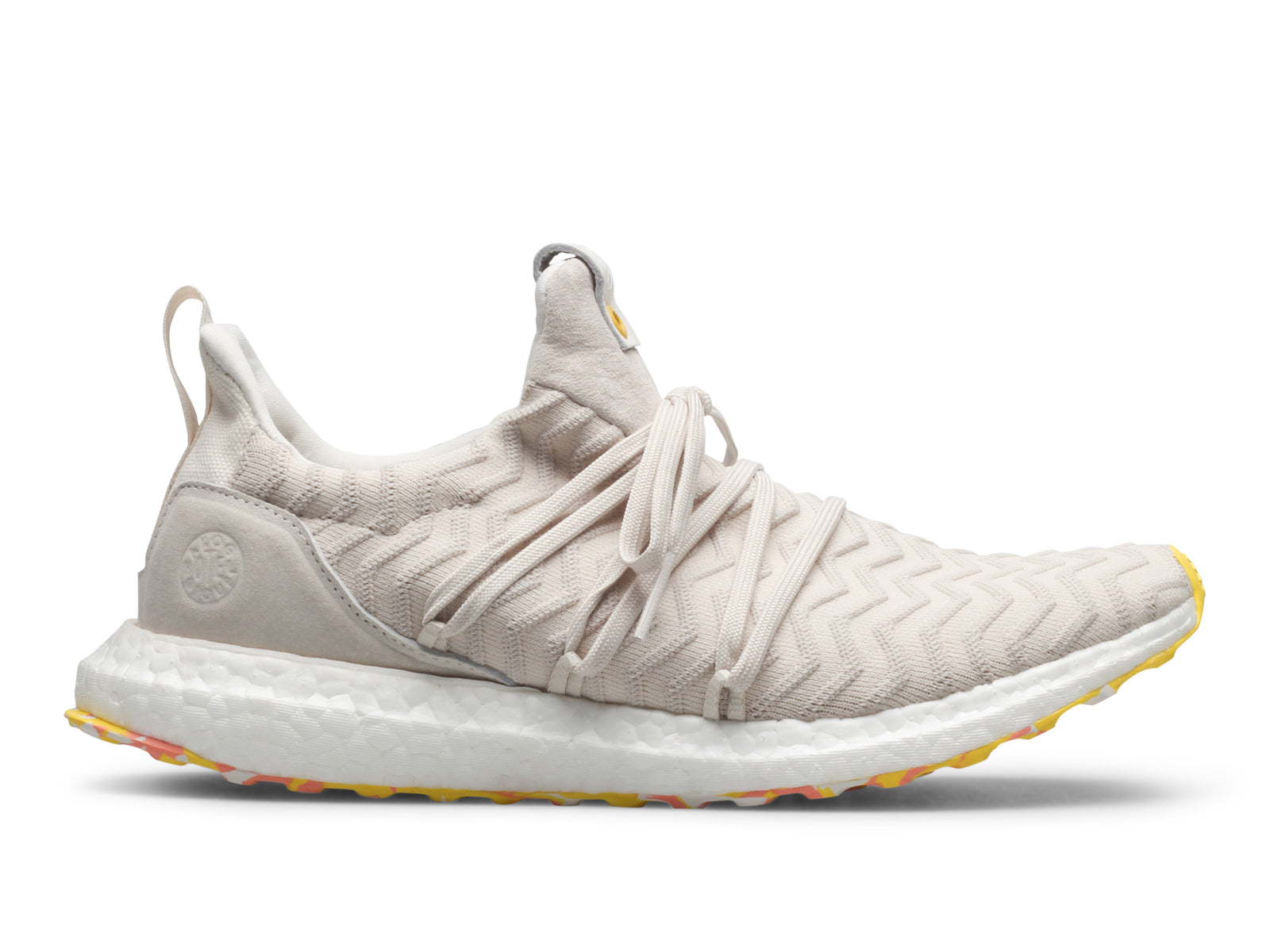 e890d39745a4a The Adidas x A.K.O.G Ultra Boost features a White Primeknit upper that  boasts a raised wave effect with an uncaged design. A wrap-around lacing  system ...