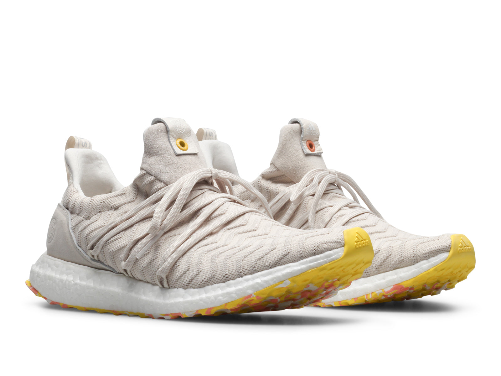 026b57463 The Adidas x A.K.O.G Ultra Boost features a White Primeknit upper that  boasts a raised wave effect with an uncaged design. A wrap-around lacing  system ...