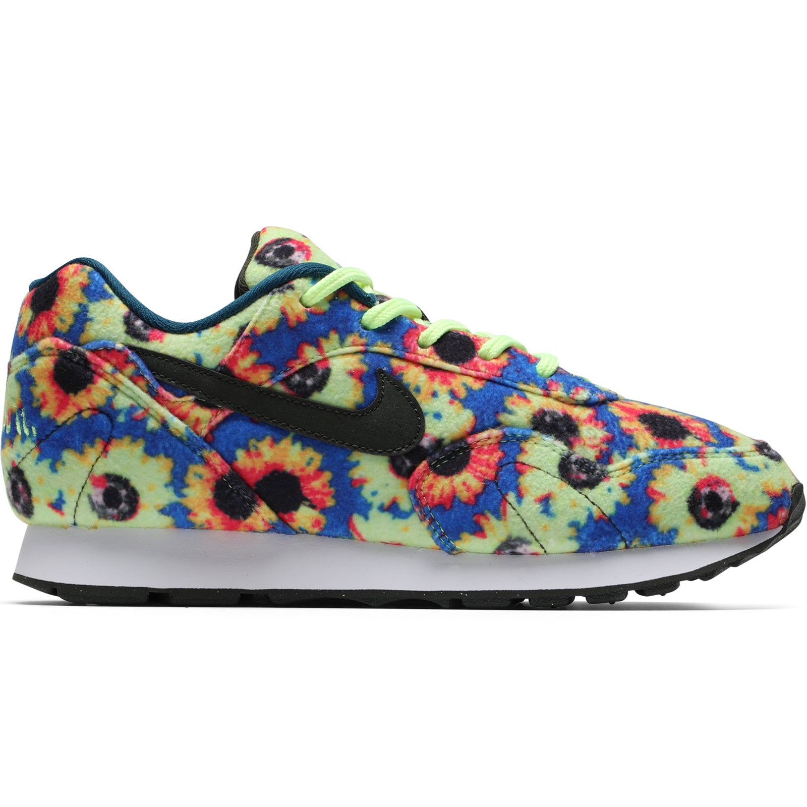 reputable site f782c 9550d ... in the back of your head somewhere, as the sleek wedge silhouette is  outfitted in an all-over floral print with a bright blue backdrop. . Nike  Outburst ...