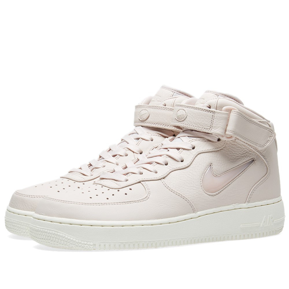 """2a122f6ab2 Monochromatic uppers are placed on top of off-white soles. The Nike Air  Force 1 Mid Retro Jewel will be set to release in three colorways including  """"Sail"""", ..."""