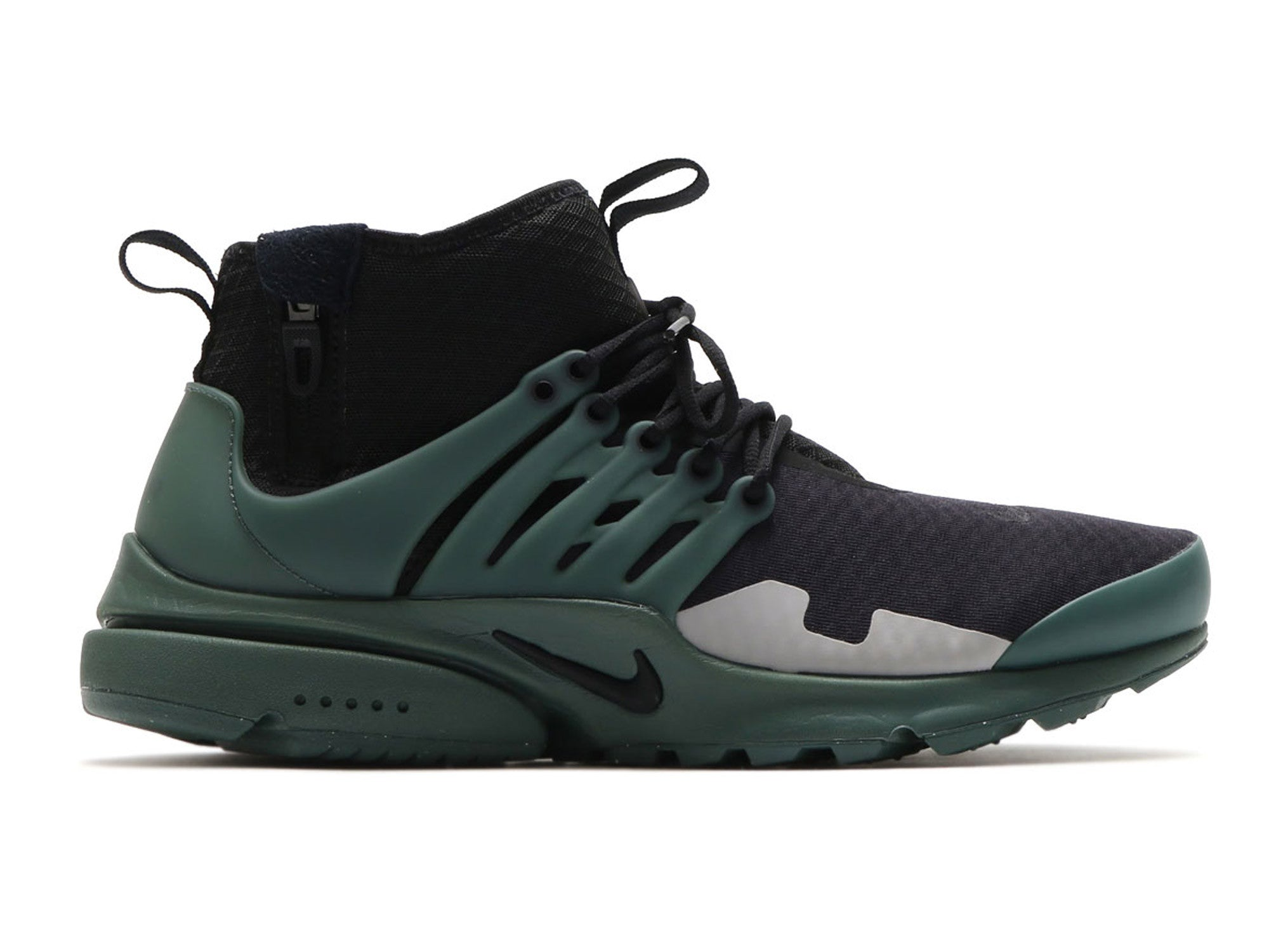 new concept 4a392 bcba0 The mid-top versions of the Nike Air Presto also includes zippers on the  ankle, front and back pull tabs.