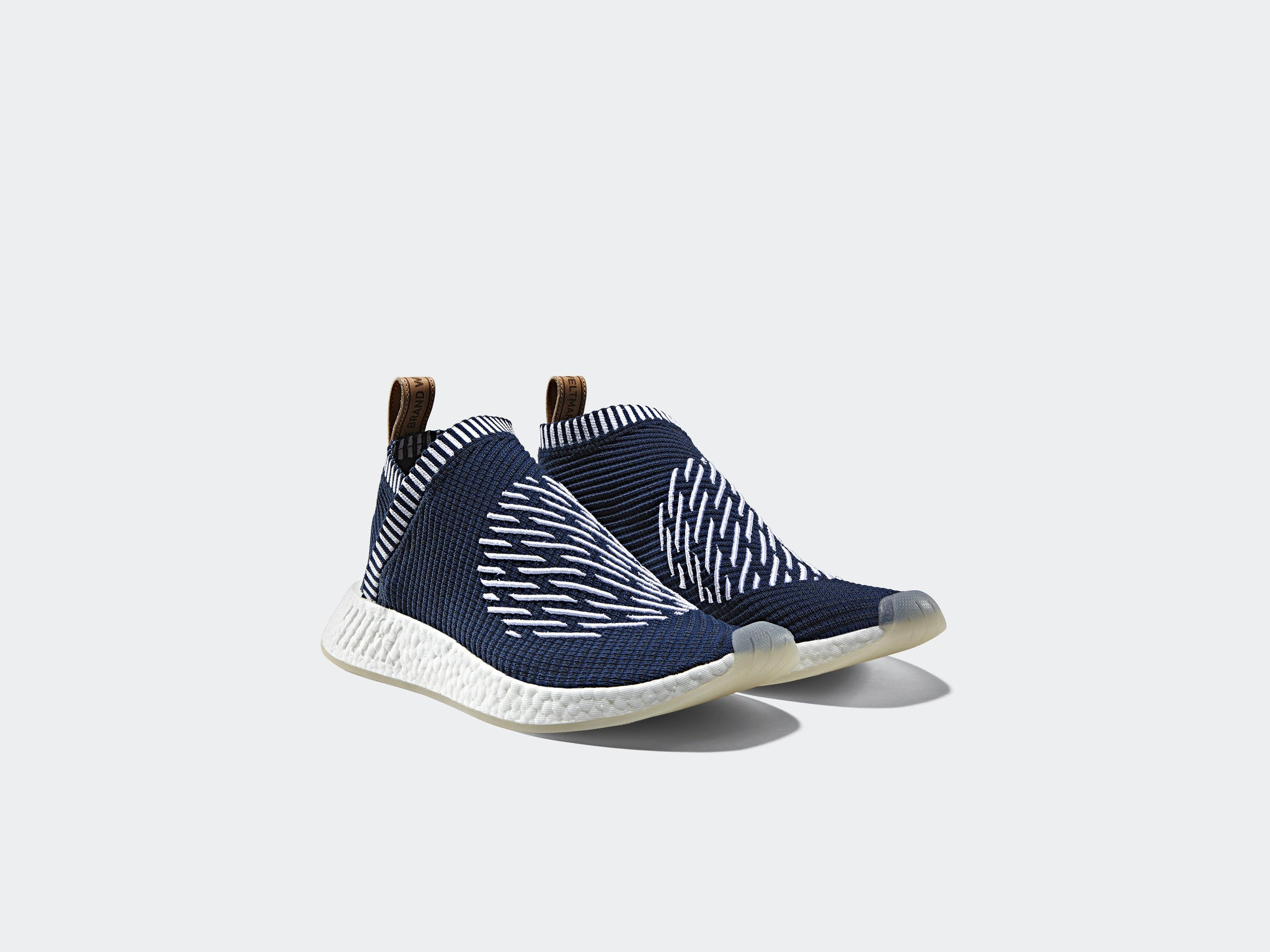 d81075d53ec1 Premium brown leather accents hit the heel tab with  Brand With The Three  Stripes  wording on the back. The restructured full-length Boost midsole  unit even ...