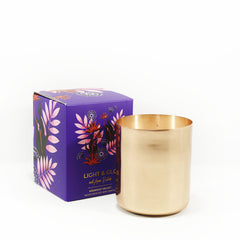 candle in copper jar with midnight velvet fragrance