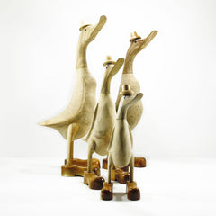 family of 4 ducks hand made from bamboo wood with hat and boots