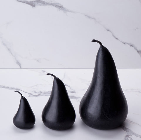 Small medium and large black marble pears