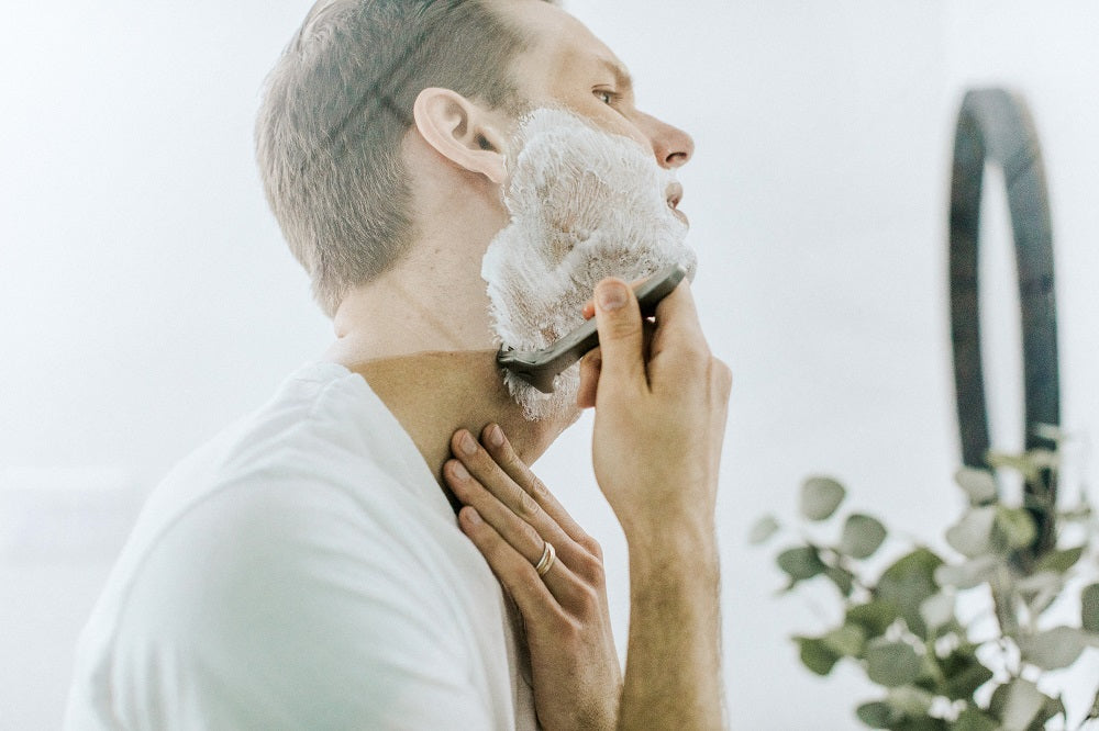 Man shaving in the mirror