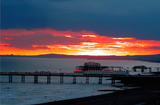 Sunset over the sea showing Brighton and The West pier (CANVAS) - LEOFRAMES