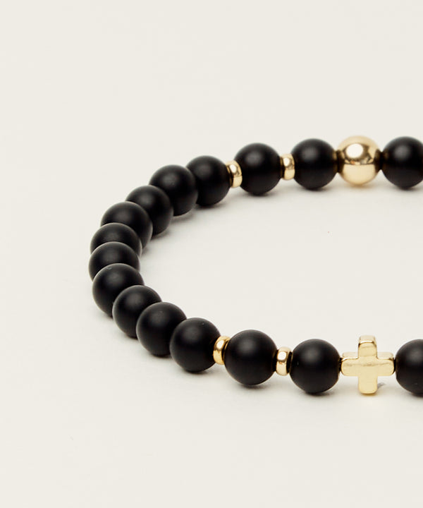 SACRED STRENGTH BRACELET WITH ONYX & 14K GOLD CROSS & HARDWARE