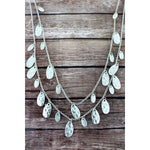 Crave Layered Worn Silvertone Petal Charm Necklace