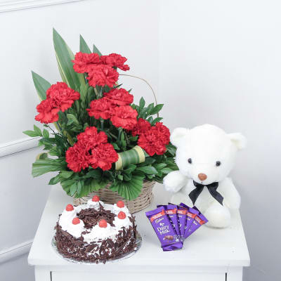 15 Red Carnations & Half Kg Black Forest Cake with Teddy & Chocolate Bars