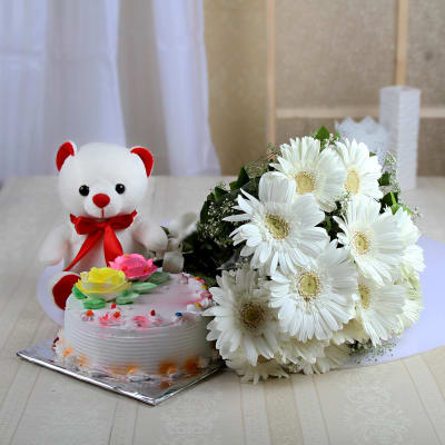 Bunch of 12 White Gerberas With 6 Inches Teddy & Half Kg Vanilla Cake