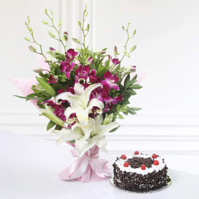 Bunch of 4 Purple Orchids & 2 Lilies with Black Forest Cake (Half Kg)