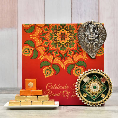Decorated Tikka Thali with Ganesha Wall Hanging and 10 Pcs Mewa Cubes in Gift Box