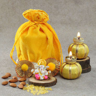 Diyas and Ganesh Idol with Mishri and Almonds